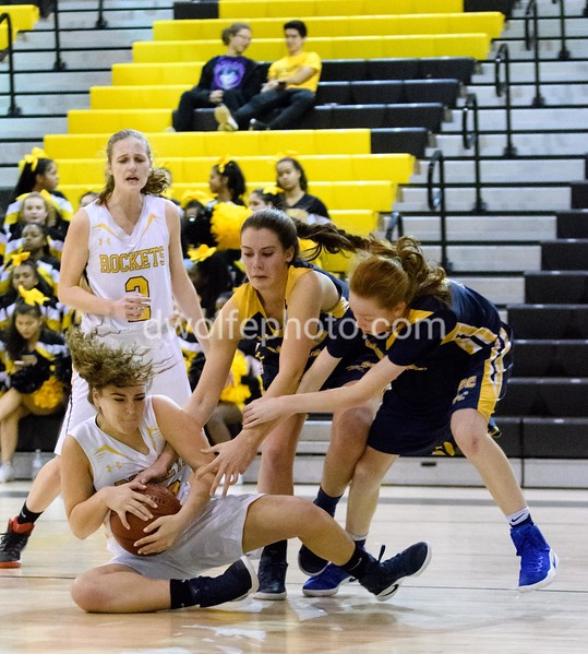 Chloe SHerman from Richard Montgomery hangs tough to force a jump ball against Bethesda Chevy Chase.