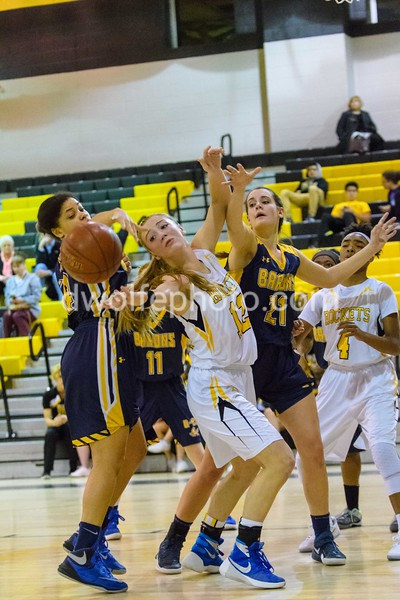 Melanie Osborne of Richard Montgomery loses the ball after Caitlyn Clendenin smacked it out of her hands in a rebound battle.