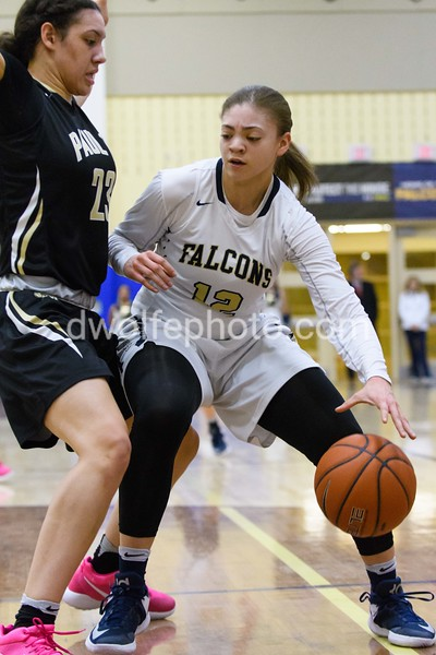 OLGC's Lindsey Pulliam  is undaunted by St Paul VI's Amira Collins as she moves into the lane for her shot.