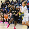 St Paul VI's Ashley Owusu muscles past Madison Hardy of OLGC.