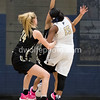 Maya Riley of OLGC fights to keep the ball on a rebound.  Reaching in to strip her of the ball is Kate Klimkiewicz of StPaul VI