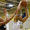 Breonna Mayfield of OLGC gets fouled by  Mikayla Vaughn of St. Paul VI.