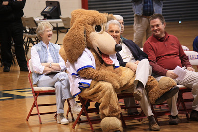 Oh no, not again Cosmo....these are the wonderful people from the Farm Bureau Insurance who sponsor the coach awards of the year for all of the areas....I hope you had clean paws when you threw them up on his nice kaki pants!!