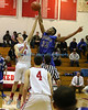 East Islip's Zach Acocella #24 and Riverhead's Brandon Toliver  #32 battle for the jump ball at the start of the Suffolk County League III Basketball Game at East Islip High School in Islip Terrace NY (Jan.  24, 2013) <br /> Photo by Daniel De Mato