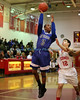 Riverhead's Quinn Funn #3 sinks a jump shot over East Islips Mike Simonetti #12 H. in the Suffolk County League III Basketball Game at East Islip High School in Islip Terrace NY (Jan.  24, 2013) <br /> Photo by Daniel De Mato