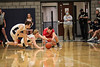 Carey's Cade Crawford (left), Ian Yeater (middle), and HL's Luke Jameson (22) dive after a loose ball.
