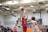 HL's Kyle Rumschlag (24) puts up a shot against VB's Connor Ohlrich (3).