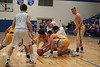 Leipsic's Tyler Hiegel (left) and Clay Gerdeman get ahold of a loose ball in front of Riverdale's Brock Davis (35) and Max Morris.