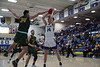 Findlay's Chris Strzempka (24) powers through the block attempt of Clay's Frank Wagenfeald (34) and sinks the jumper.