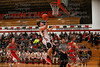 McComb's Dakota Bowling (3) finishes a fastbreak with a layup above PH's Alex VanDeBussche (10).