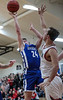 Riverdale's Logan Frey (24, left) is fouled as he shoots against Arlington's Tyson Speyer (33).
