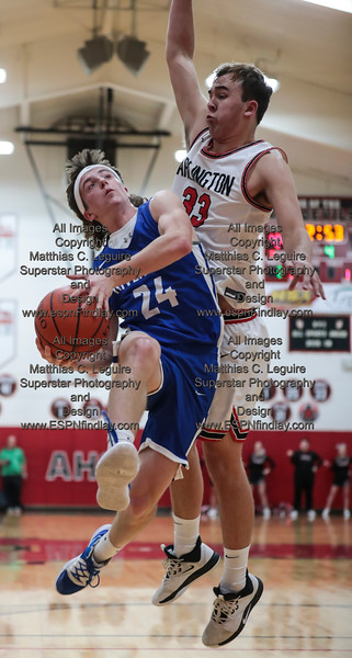 Riverdale's Logan Frey (24, left) protects the ball as he goes for a layup against Arlington's Tyson Speyer (33).
