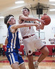 Riverdale's Logan Frey (24, left) knocks the ball away from Arlington's Jaret Vermillion (1) as he goes up for a layup.