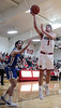 Arlington's Jaret Vermillion (1) lays in a basket in front of Riverdale's Trysten Mix (30).