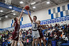 Elmwood's Caleb Plouck (2, middle) drives baseline past Rossford's CamRon Gaston (2, right) but his shot is blocked by Ethan Dewese (3, left).