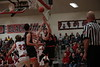 VB's Brady Rader (10) is fouled as he banks a shot off the glass over Arlington's Ivan Berry (13).