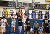 Findlay's Drew Hapner (33) and Kyle Nunn (15) combine to block a shot by Whitmer's Nick Witcher (24).