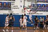 After Whitmer's Derrick Rayford Jr. (1) got around Findlay's Ryan Nunn (20) teammate Drew Hapner (33) came over to help and swatted away Rayford's shot.