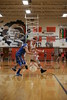 Upper's Wes Vent (22) drives into the lane against Wynford's Zach Hoffman (14).