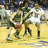 Michael Gulino (12) heads for the basket, being followed by Pishon Powell (33) in the first half.