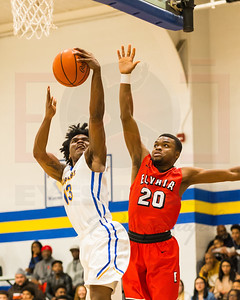 Clearview #13 Todd Javon drives to the basket as Elyria #20 Deviian Williams looks to defend the basket. photo Joe Colon Saturday January 27, 2018