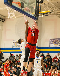 Elyria #35 Justin Koepp with the strong move to the basket over Clearview #1 Sam Daniels Saturday January 27. photo Joe Colon