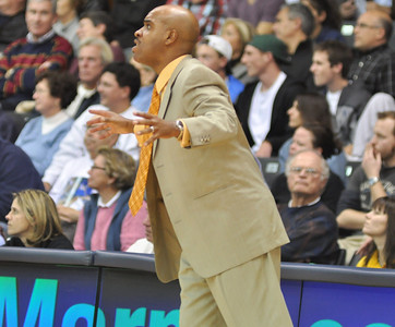 Coach Ross tells his team to spread out the defense a bit more