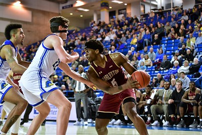 Jarrell Brantley fights off Jacob Cushing (22) and Eric Carter (5) of Delaware