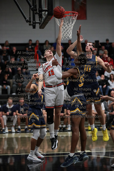 UF's Ethan Linder (15) banks the ball off the glass for a layup surrounded by Cedarville's Demond Parker (1), Kollin Van Horn (10), and Quinton Green (55).