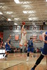 UF's Austin Gardner (2) pulls up and shoots a three against Hillsdale's Zach Miller (11).