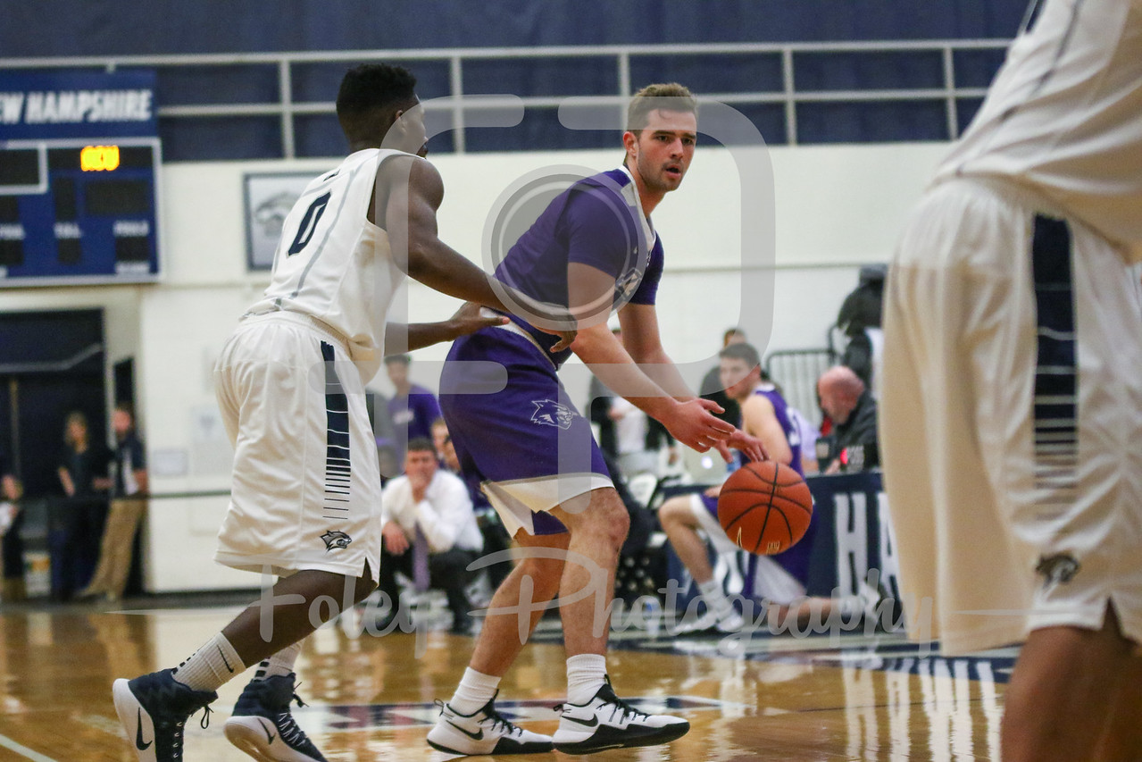 Abilene Christian Wildcats guard Jovan Crnic (4) New Hampshire Wildcats guard Jaleen Smith (0)