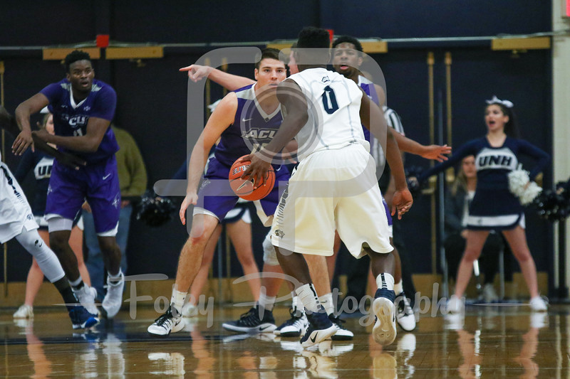 Abilene Christian Wildcats forward Hayden Farquhar (15) New Hampshire Wildcats guard Jaleen Smith (0)