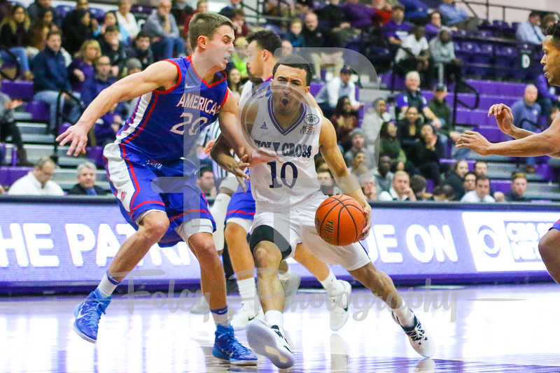Holy Cross Crusaders guard Patrick Benzan (10) American University Eagles guard Charlie Jones (20)