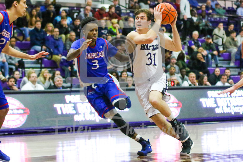 Holy Cross Crusaders guard Matt Zignorski (31) American University Eagles guard James Washington (3)