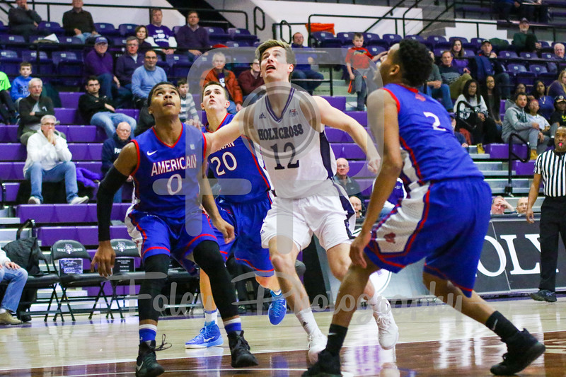 Holy Cross Crusaders guard Clayton Le Sann (12) American University Eagles guard Sa'eed Nelson (0)