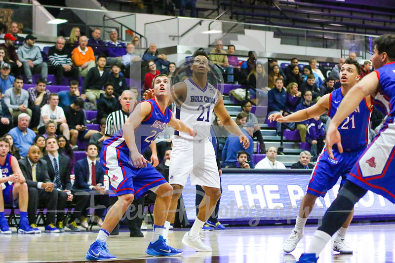 American University Eagles guard Charlie Jones (20) Holy Cross Crusaders forward Malachi Alexander (21)