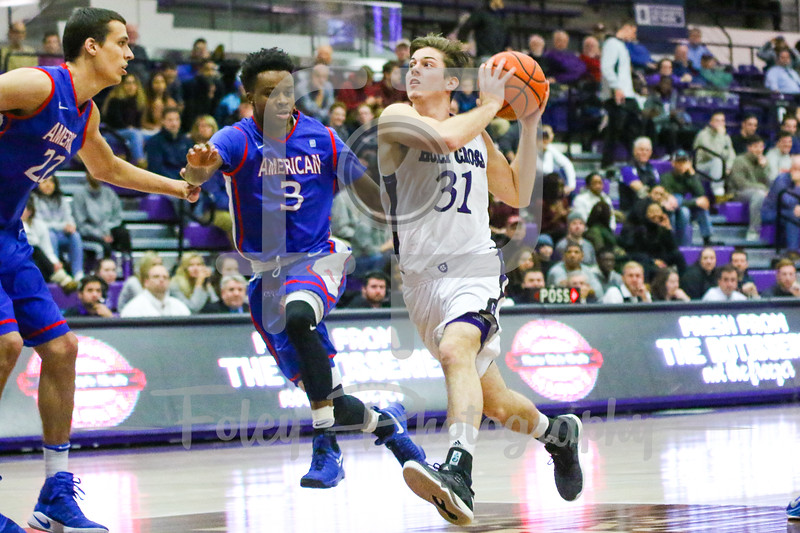 Monday, January 23, 2017; Worcester, MA; Holy Cross Crusaders guard Matt Zignorski (31) drives to the hoop on American University Eagles guard James Washington (3)  during the Crusaders 63-55 victory over the Eagles.