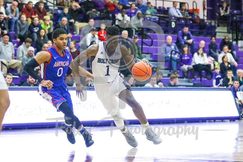 Holy Cross Crusaders forward Karl Charles (1) American University Eagles guard Sa'eed Nelson (0)