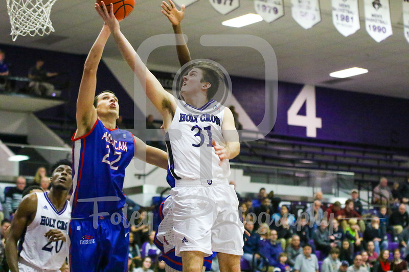Holy Cross Crusaders guard Matt Zignorski (31) American University Eagles forward Matt Cimino (22)