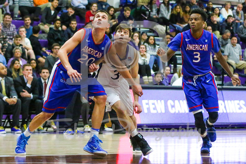 American University Eagles guard Charlie Jones (20) Holy Cross Crusaders guard Matt Zignorski (31)
