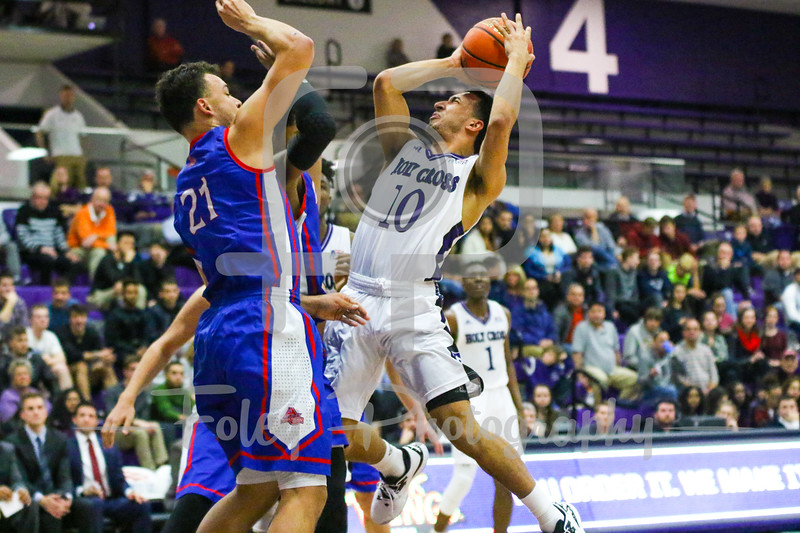 Holy Cross Crusaders guard Patrick Benzan (10) American University Eagles guard Jalen Rhea (21)