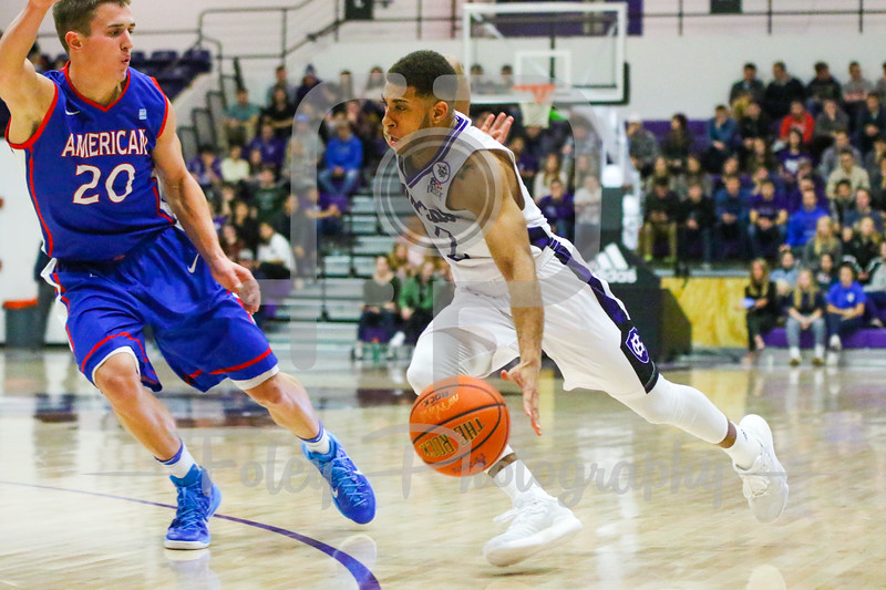 Holy Cross Crusaders guard Anthony Thompson (2) American University Eagles guard Charlie Jones (20)