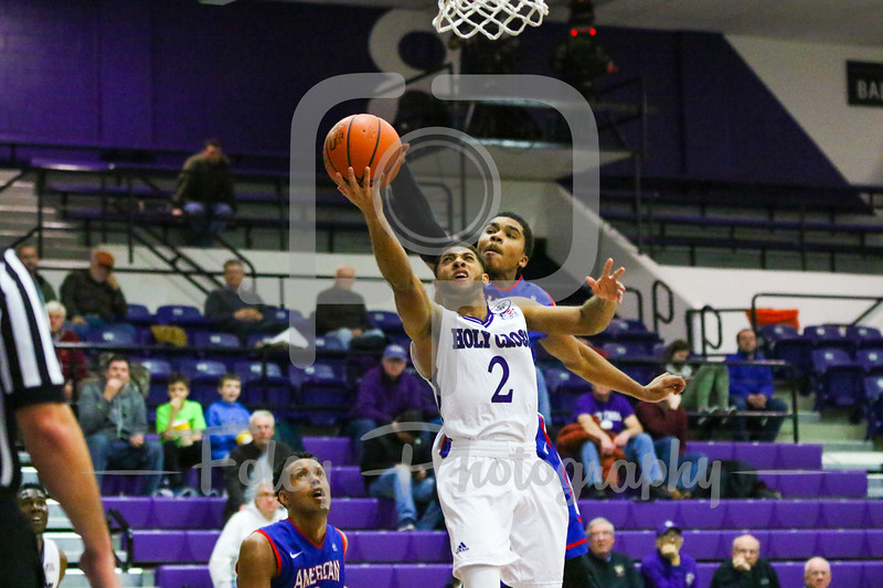 Holy Cross Crusaders guard Anthony Thompson (2) American University Eagles guard Sa'eed Nelson (0)