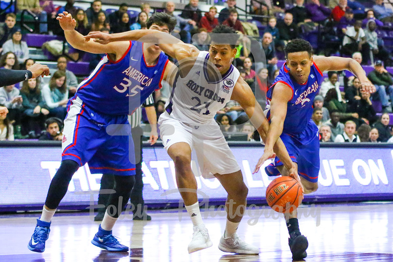 Holy Cross Crusaders forward Malachi Alexander (21) American University Eagles guard Delante Jones (2)