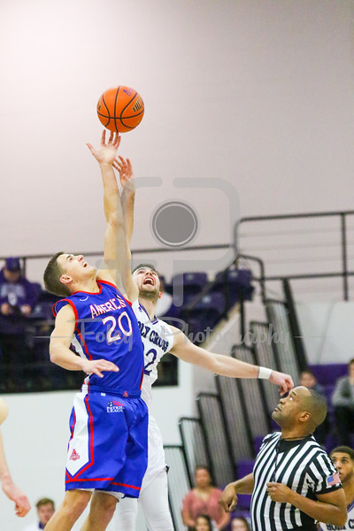 American University Eagles guard Charlie Jones (20) Holy Cross Crusaders guard Robert Champion (22)