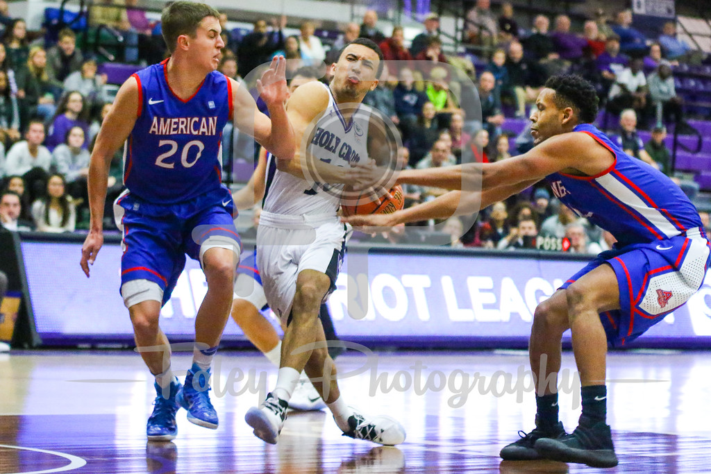 Holy Cross Crusaders guard Patrick Benzan (10) American University Eagles guard Delante Jones (2)