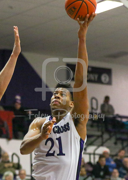 Holy Cross Crusaders forward Malachi Alexander (21) Bucknell Bison center Nate Sestina (4)