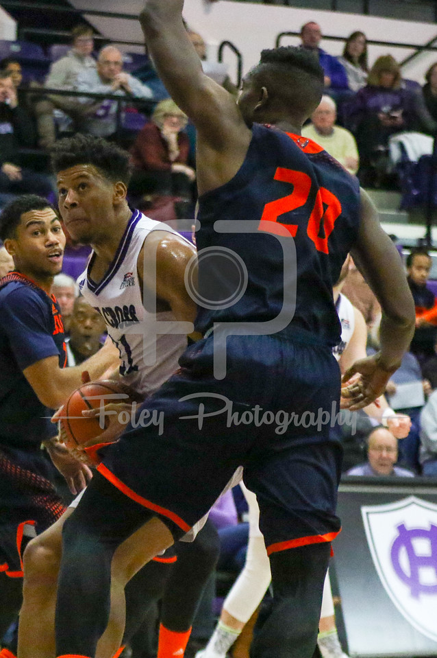 Holy Cross Crusaders forward Malachi Alexander (21) Bucknell Bison center Nana Foulland (20)