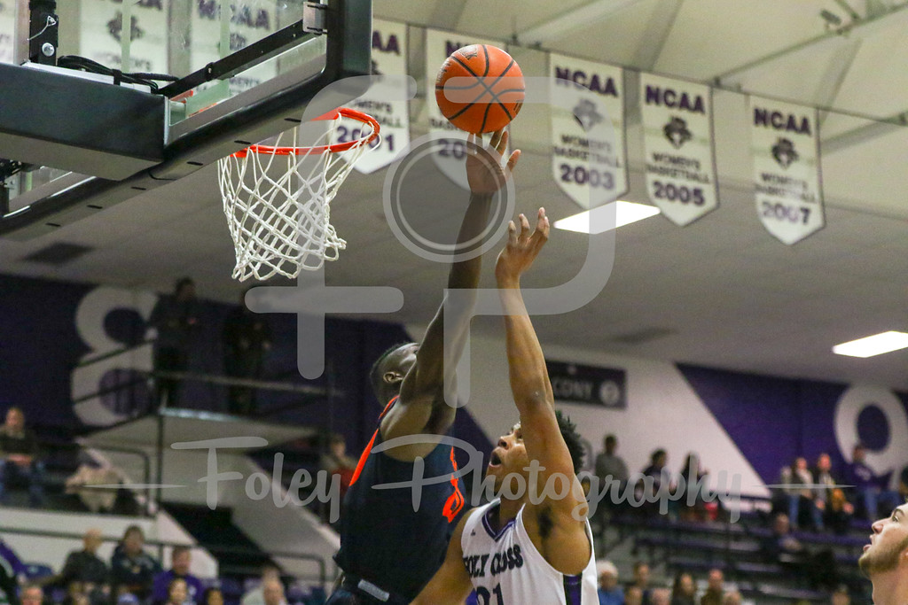 Bucknell Bison center Nana Foulland (20) Holy Cross Crusaders forward Malachi Alexander (21)