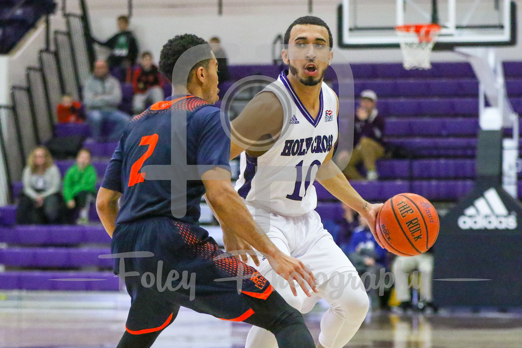 Holy Cross Crusaders guard Patrick Benzan (10) Bucknell Bison guard Stephen Brown (2)